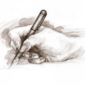 Hand holding writing pen